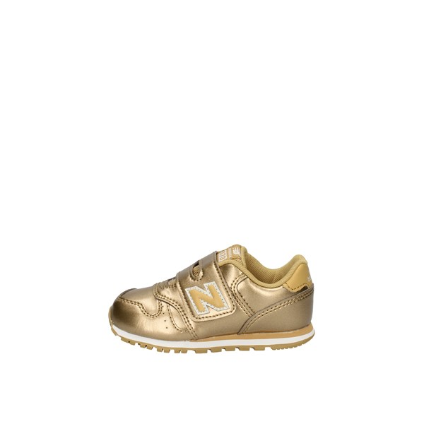 New Balance low Gold